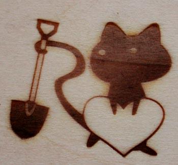 猫とスコップの焼印