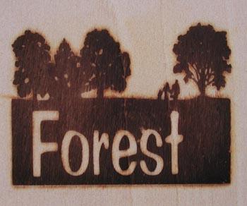 大地と樹木と人の焼印