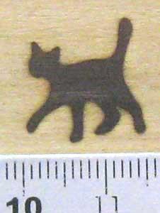 猫焼印を木へ