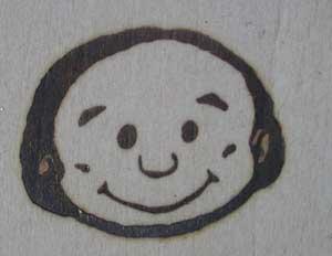 人の顔焼印2