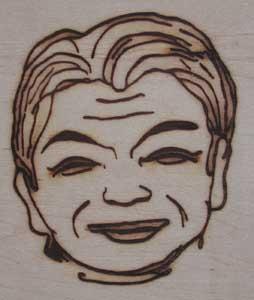 人の顔焼印5