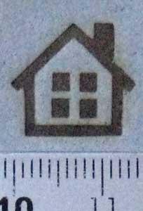紙に家の焼印を押す